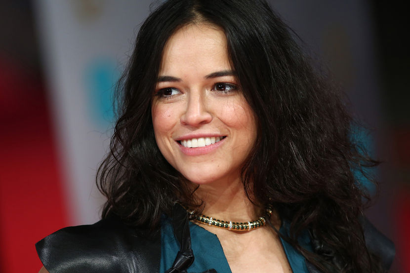 US actress Michelle Rodriguez arrives on the red carpet for the BAFTA British Academy Film Awards at the Royal Opera House in London on February 16, 2014. AFP PHOTO / ANDREW COWIE